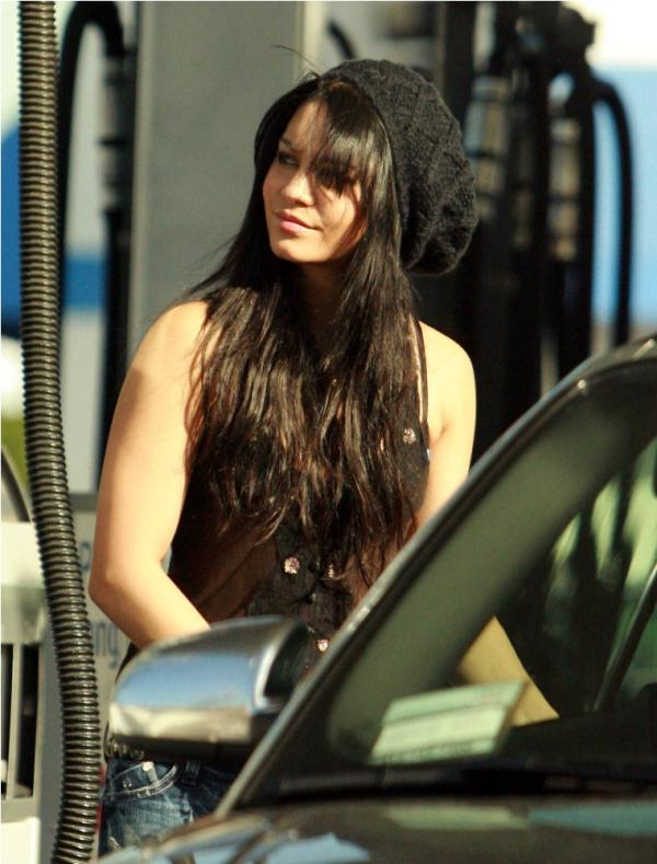 Vanessa Hudgens looking sexy wearing a see-through blouse while pumping gas